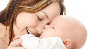 Mother smile to her child, isolated over white